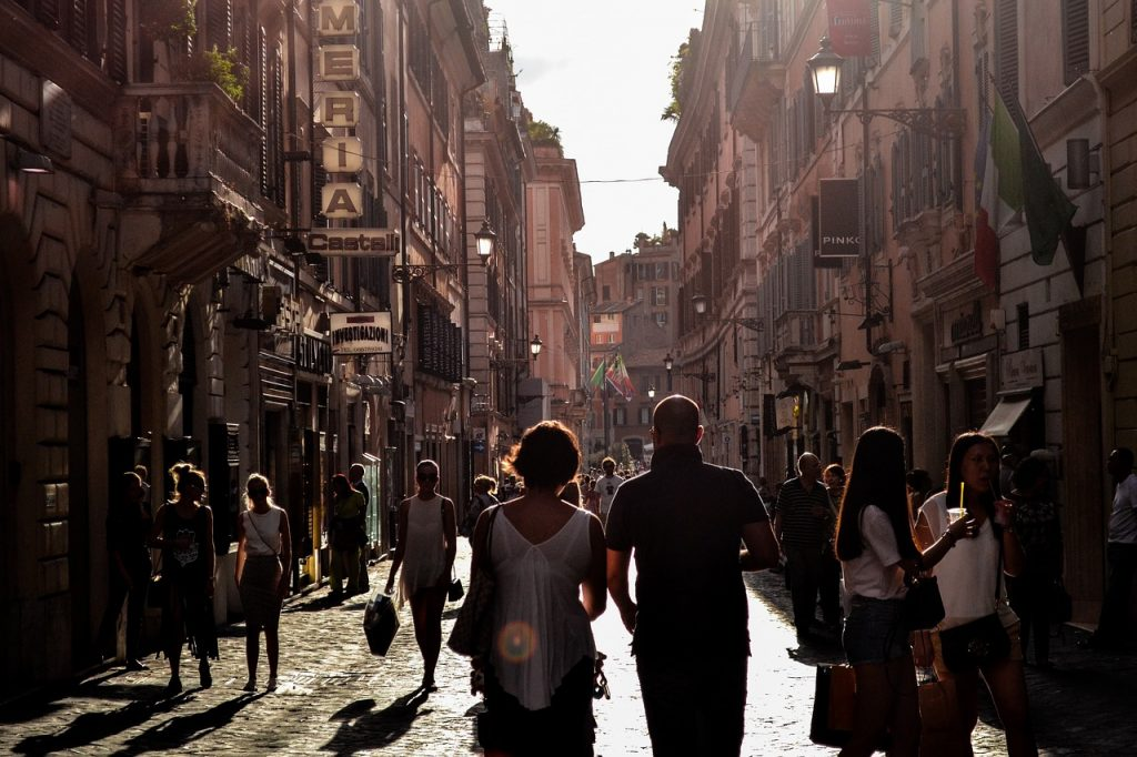 Man and women walking in a crowded city